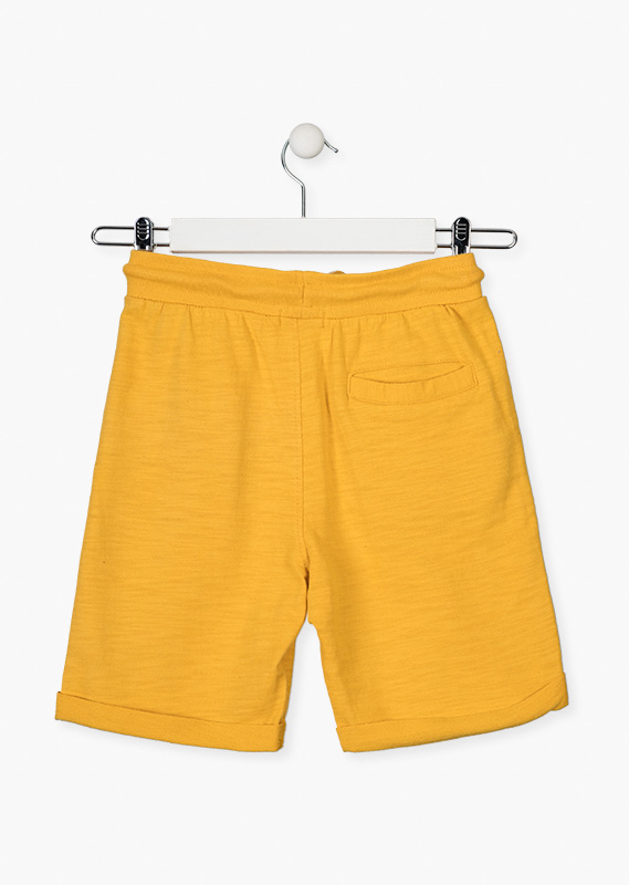 Yellow shorts with roll-up detail.