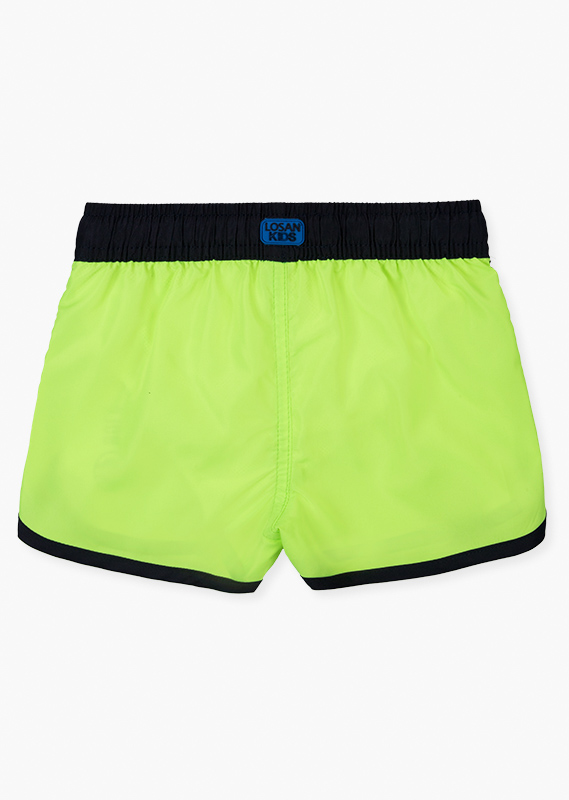 Yellow swim trunks with side print front.