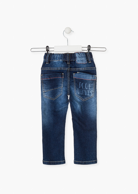 Plush effect jeans with ornamental cord.