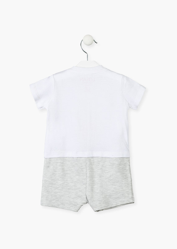 Organic cotton romper in white and grey.