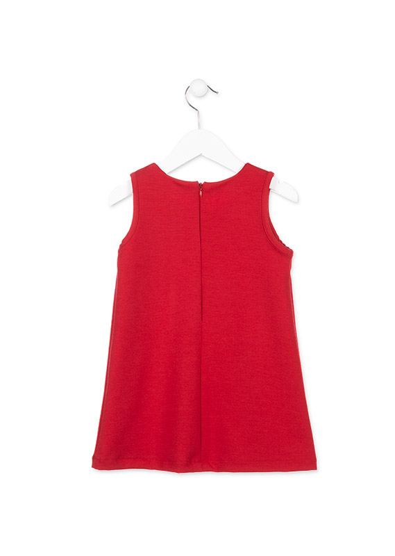 Red pinafore dress with pockets.
