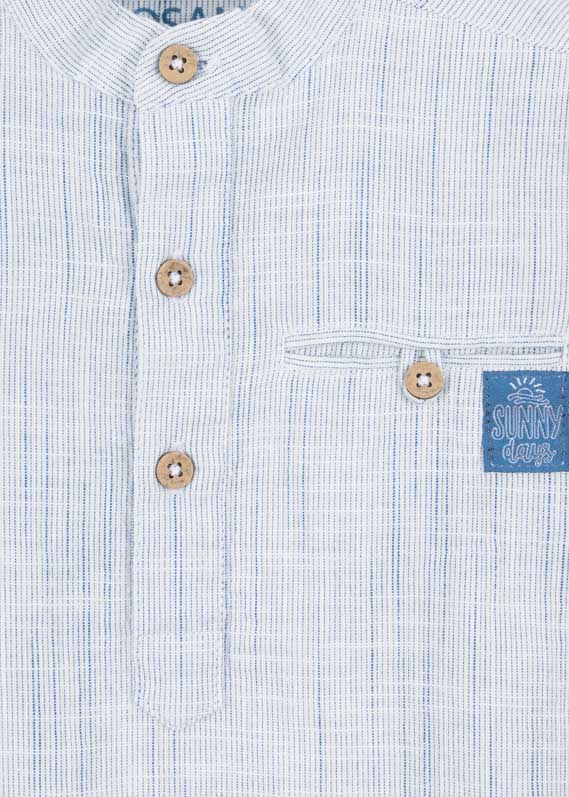 Shirt with welted breast pocket.