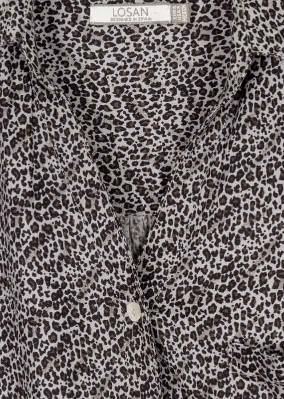 Animal print blouse.