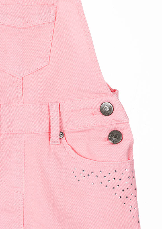 Salopette a gonna di twill di colore rosa con brillantini.