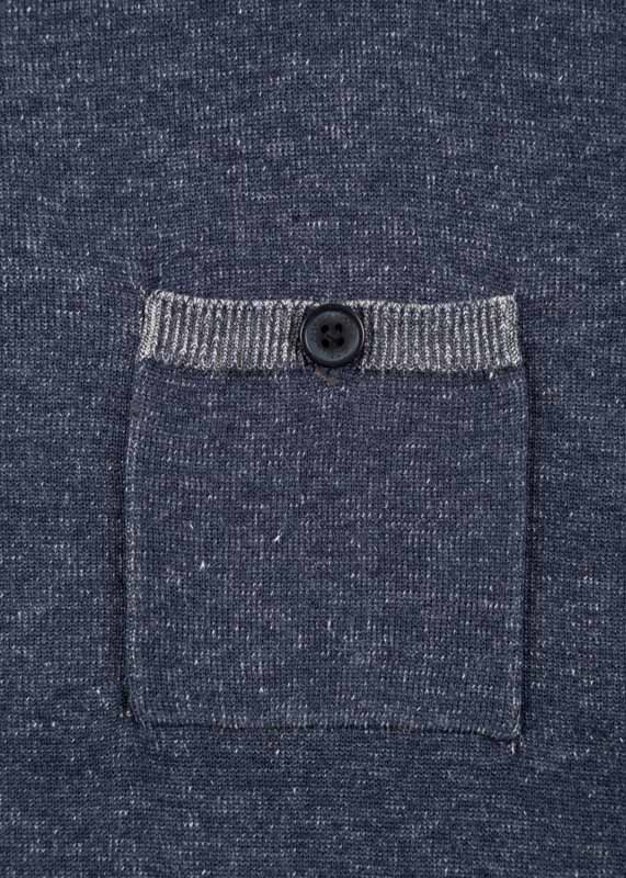 Knit jumper featuring a button pocket on the chest.