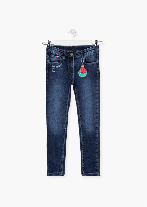 Trousers with embellished keyring at belt loop.