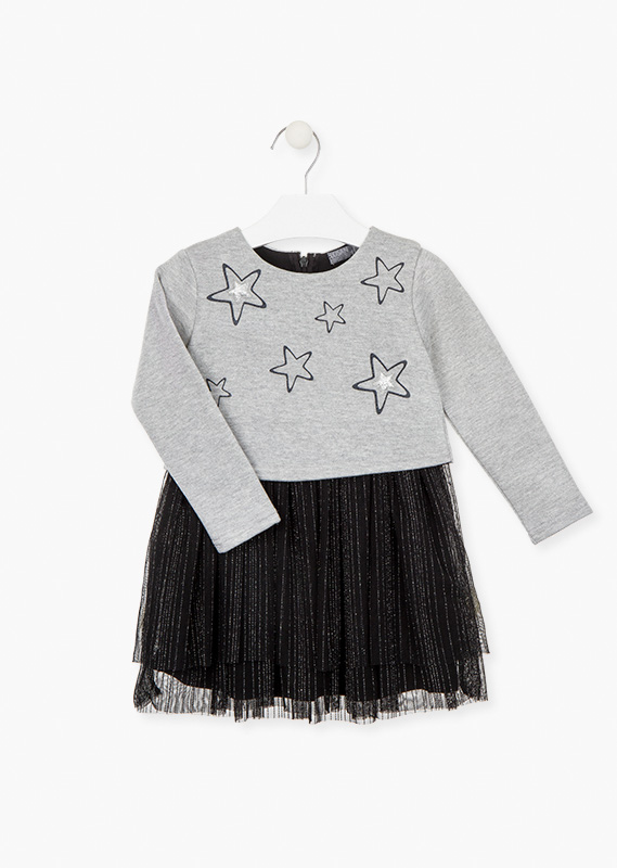 Fabric mix dress with printed stars and patches.
