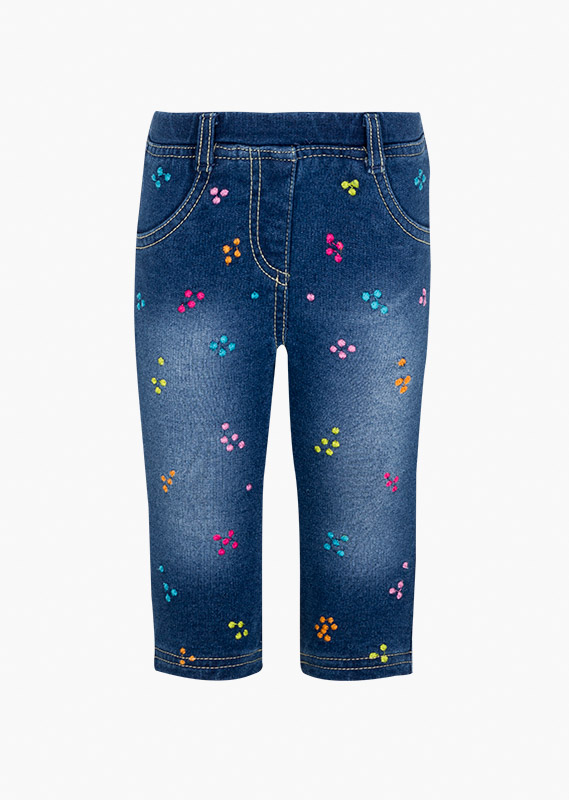 Jeggings di felpa jeans con ricami colorati.