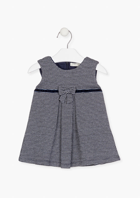 Sleeveless dress in houndstooth motif.